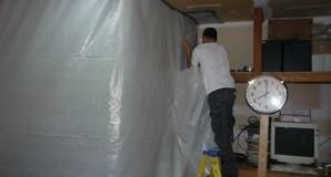 Technician Installing Vapor Barrier For Mold Cleanup