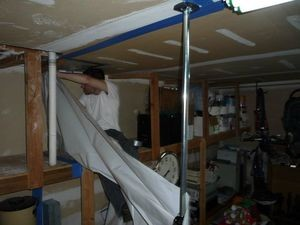 Installing A Vapor Barrier To Contain Mold Spores During A Cleanup